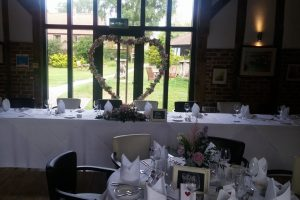 Wedding decor and head table set up with floral arrangements