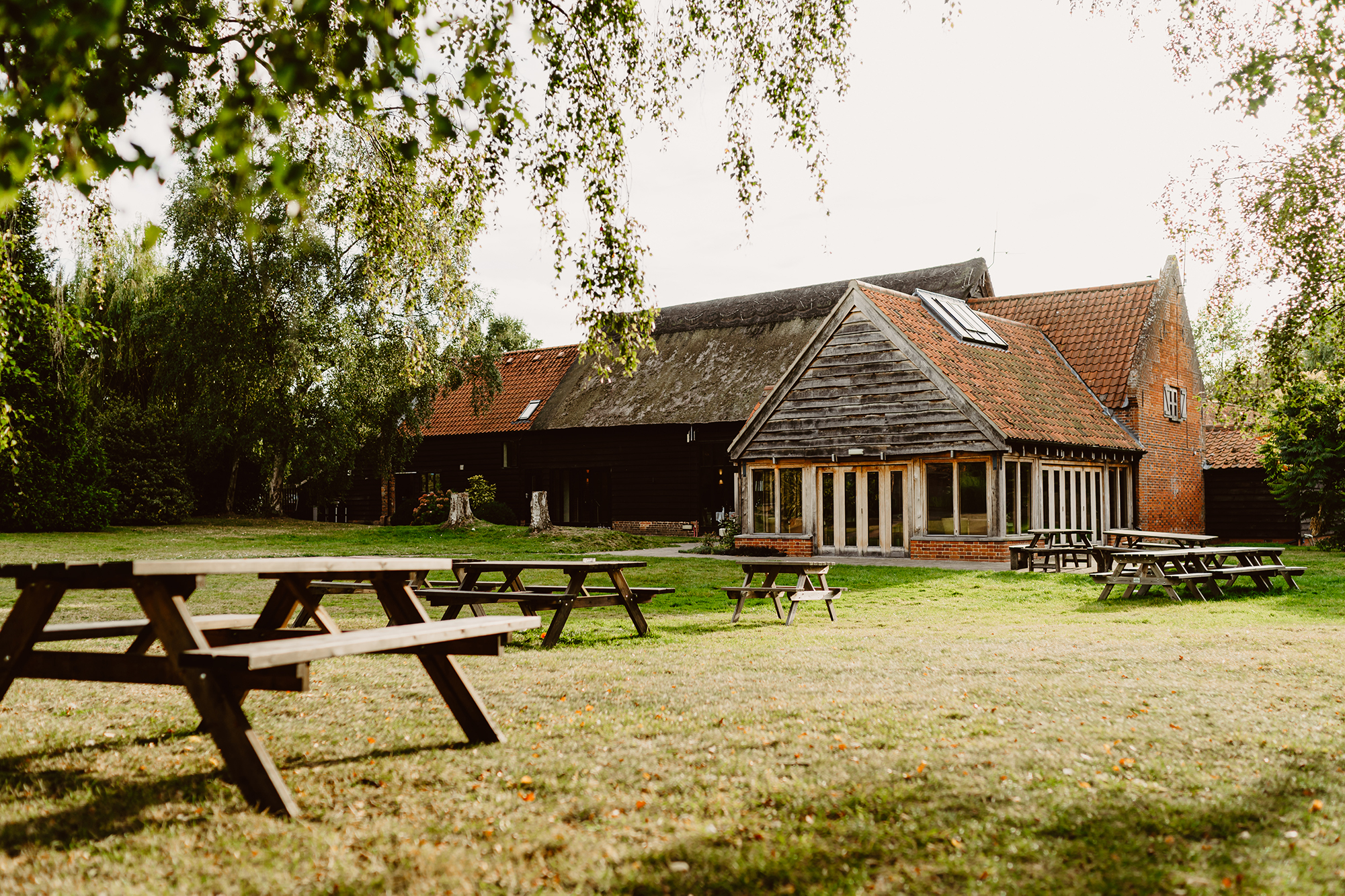 Ivy House Country Hotel Wedding Venue Backyard with Picnic Tables