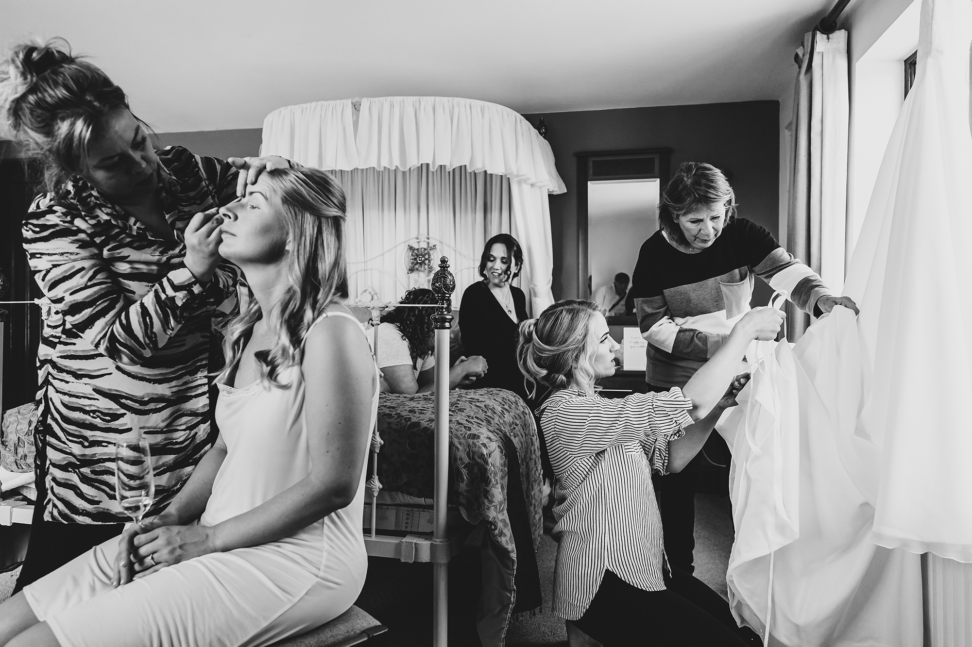 Black and White Photo of Bridal Party Getting Hair & Makeup Done for a Wedding at Ivy House Country Hotel