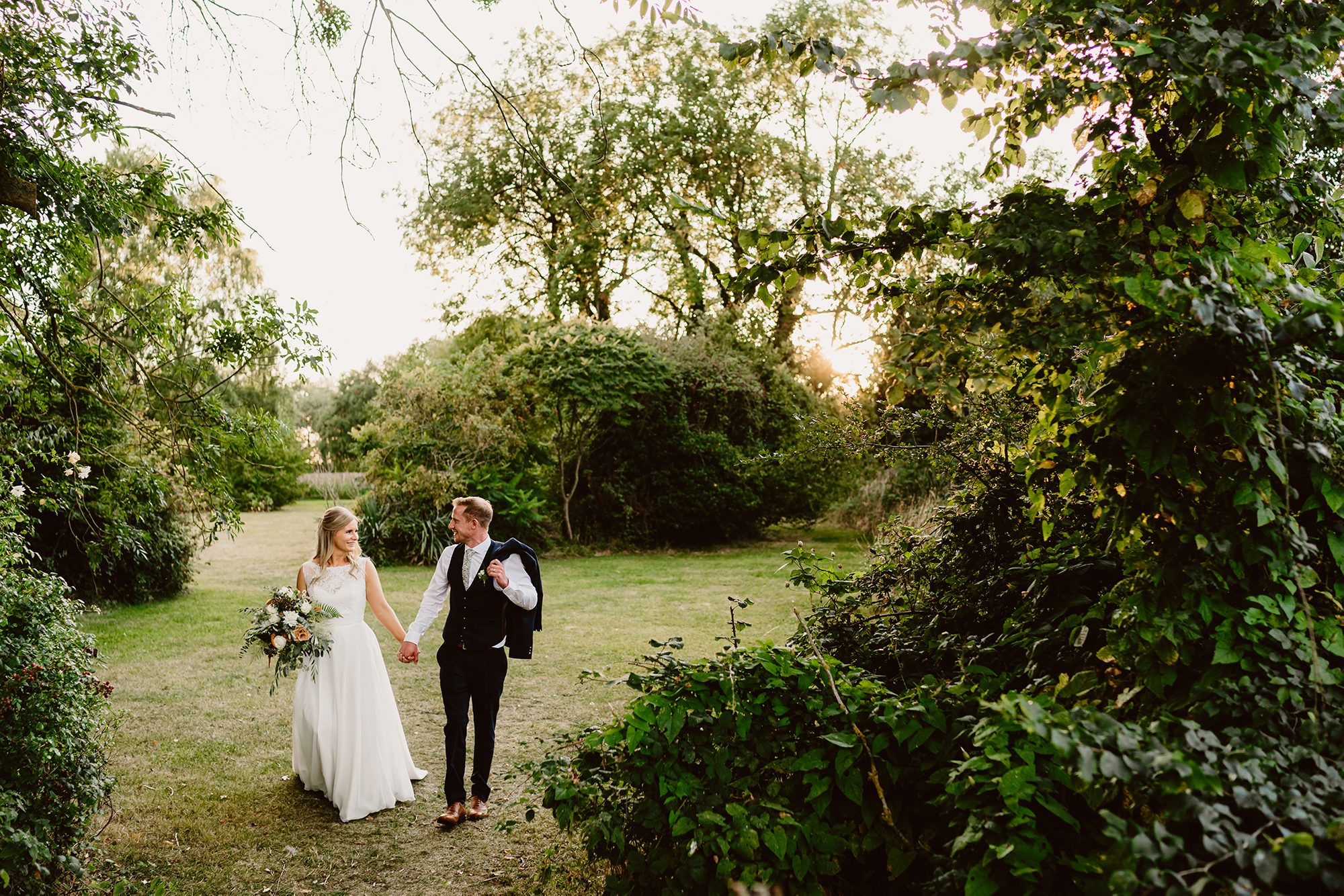 Husband and Wife Genevieve & John Walking Hand in Hand at Ivy House Country Hotel