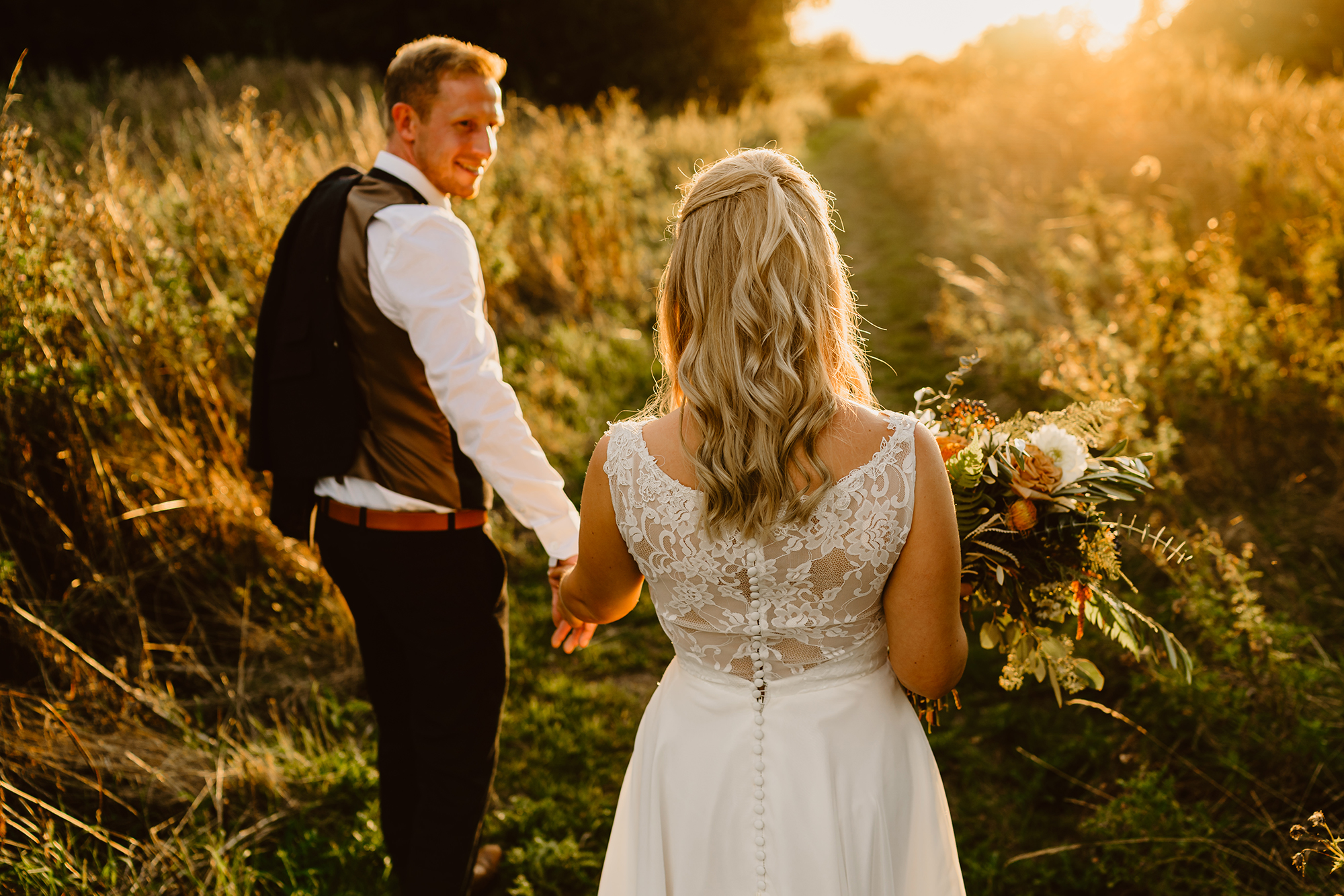Bride and Groom Genevieve & John Walking the Gardens at Ivy House Country Hotel During Sunset