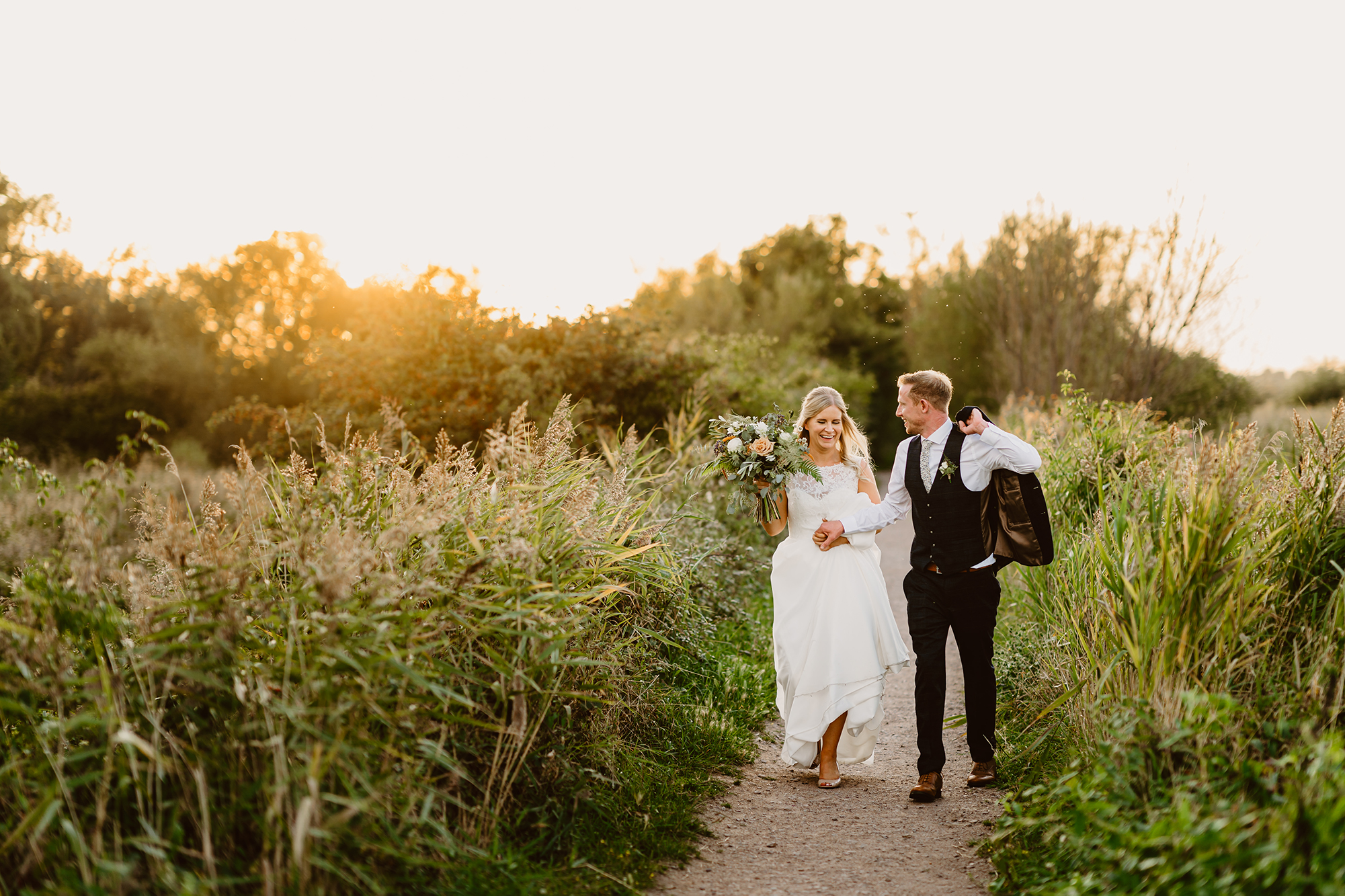 Newlyweds Walking Through the Gardens at Ivy House Country Hotel During Sunset