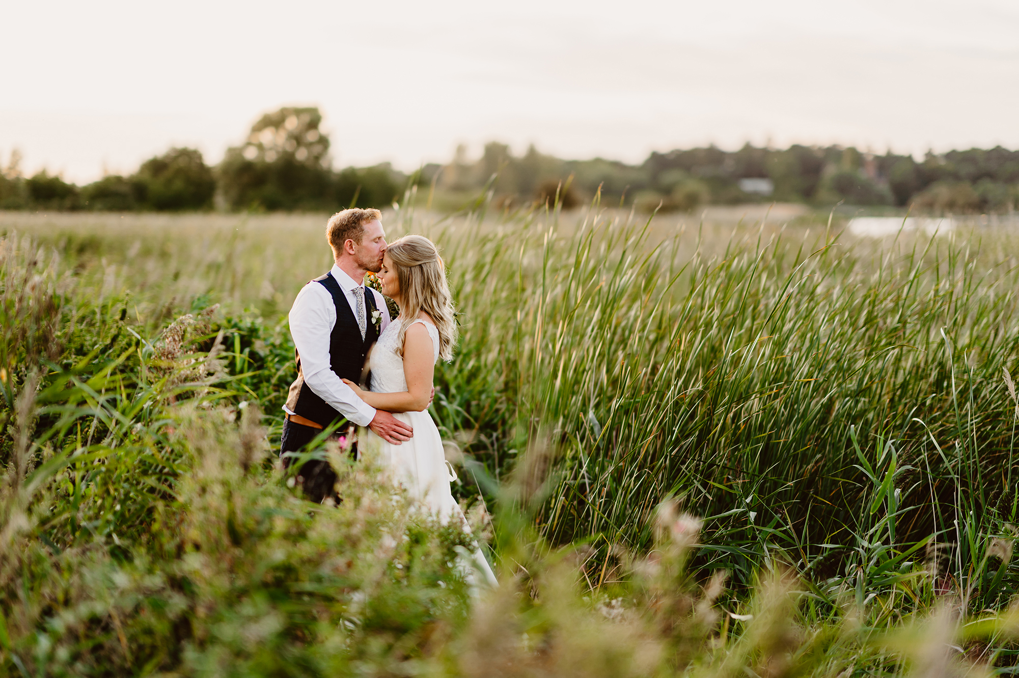 Newlyweds Share Hug and Kiss at Ivy House Country Hotel Gardens