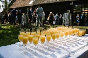 Buck fizz flutes and wedding guests
